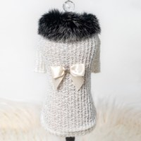 Just in time for the change of season, keep your baby stylish and warm in our new sweater collection. The high society sweater is made from light soft wool and has a faux mink collar, it is accented with signature bow.